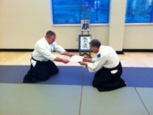 Greg-san receives his Sankyu certificate from Blevins Sensei.