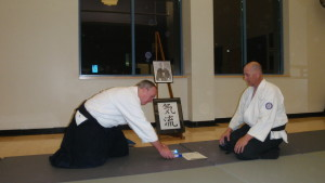 Andrew Blevins Sensei honors Les Steveson Sensei for more than 2,500 hours of training and dedication to the dojo.